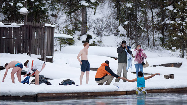 Teenagers taking a swim in icy waters  at Lake Louise by Robert Berdan ©