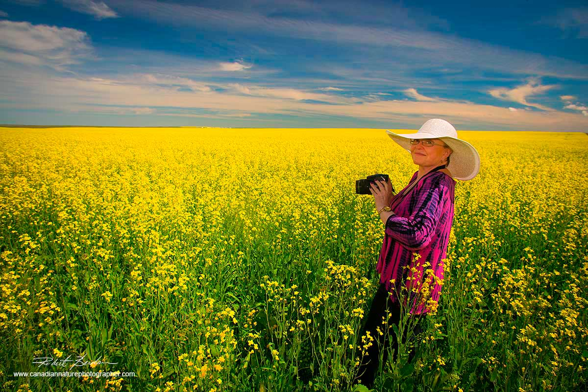 Dr. Margaret McNay - standing in a conola field taking pictures near Jenner Alberta. by Robert Berdan ©