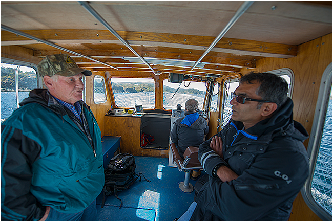 Ic eberg man tours Twillingate by Robert Berdan ©
