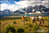 Modern cowboy with horse overlooking the Tonquin Valley in Jasper National Park by Robert Berdan