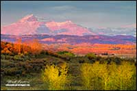 Rocky mountain foothills in autumn at sunrise by Robert Berdan