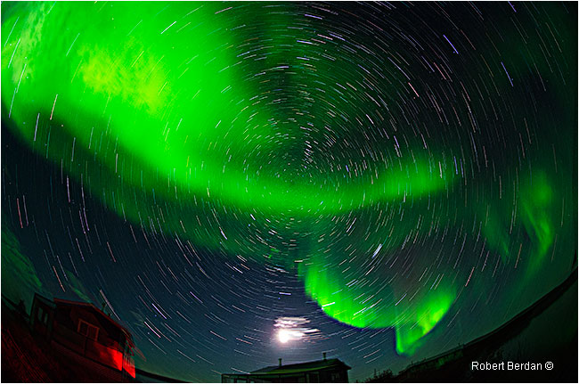 Moon, cabins, aurora and star trails over Point Lake, NWT by Robert Berdan ©