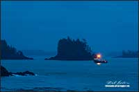 Fishing boat returning Uclulet harbour early morning, Vancouver Island by Robert Berdan