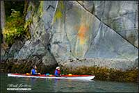 First Nations pictograph and kayakers near Broughton Archipelago British Columbia by Robert Berdan